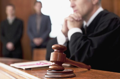 Judge and gavel in courtroom --- Image by © 237/Chris Ryan/Ocean/Corbis